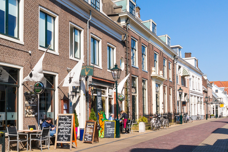streetscene: People on outdoor terrace of cafe on Cattenhagestraat street in old town of Naarden, North Holland, Netherlands Editorial
