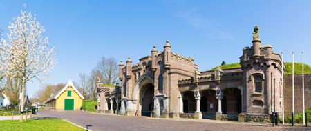 streetscene: Panorama of city gate Utrechtse poort in old fortified town of Naarden, North Holland, Netherlands