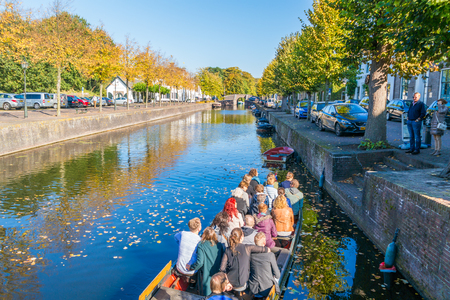 cruising: People in tourist boat on canal in old fortified town of Naarden, North Holland, Netherlands
