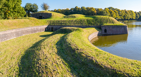bastion: Bastion Promers with barracks and moat of old fortified town of Naarden, North Holland, Netherlands Editorial