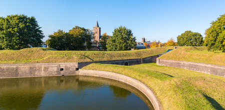 Panorama of Big Church and rampart with bastion Promers in old fortified town of Naarden, North Holland, Netherlands Editorial