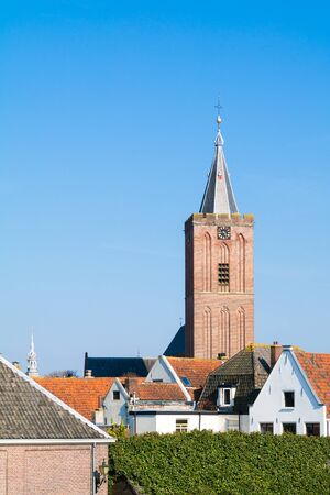 Tower of Big Church or Saint Vitus Church and rooftops of houses in old town of Naarden, North Holland, Netherlands