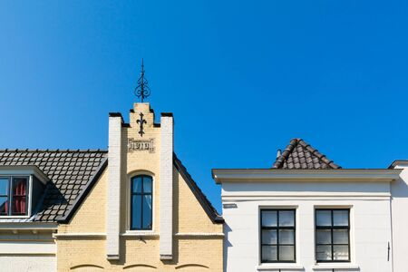 house gables: Top facades of historic houses on Turfpoortstraat in old town of Naarden, North Holland, Netherlands Editorial