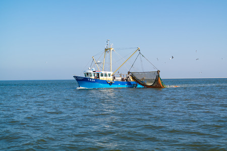 Commercial outrigger trawler shrimp fishing on Waddensea, Netherlands