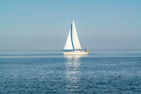 pleasure craft: WADDENSEA, NETHERLANDS - SEP 13, 2016: Sailboat sailing at calm and sunny Waddensea, Netherlands Editorial