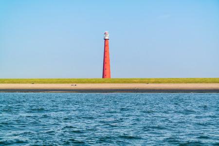 Vuurtoren Lange Jaap aan de Noordzeekust van Huisduinen bij Den Helder, Nederland