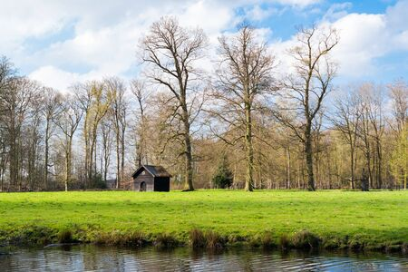 Small shed, meadow and ditch at country estate Boekesteyn, s Graveland, North Holland, Netherlands