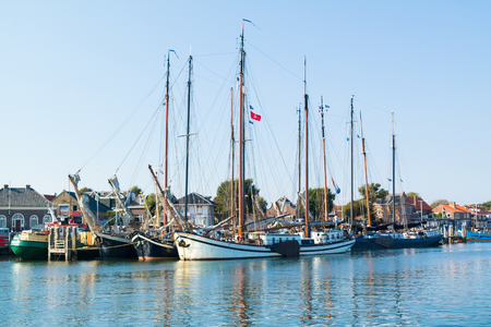 TERSCHELLING, NETHERLANDS - SEP 12, 2016: Traditional sailing ships of brown fleet in harbour on Wadden sea island Editorial