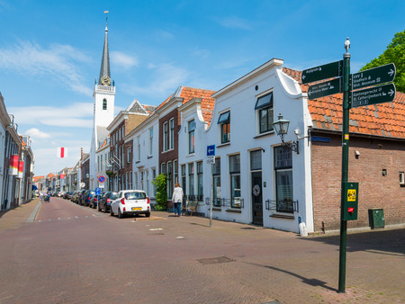 Street scene of Voorstraat with Saint Jacobs Church in old town of Brielle, Voorne-Putten, South Holland, Netherlands