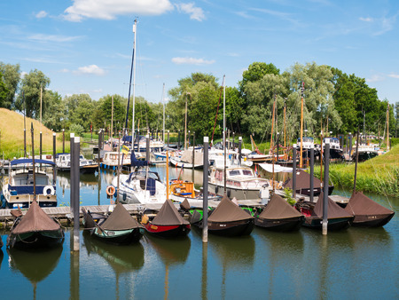 Traditional and pleasure boats in marina of fortified town of Woudrichem, Brabant, Netherlands