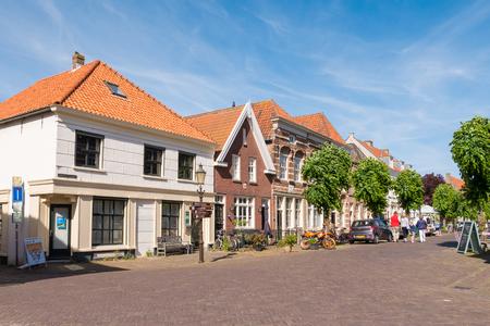 WOUDRICHEM, NETHERLANDS - JUN 4, 2017: Street scene of  Hoogstraat in old town of fortified city of Woudrichem, Brabant, Netherlands