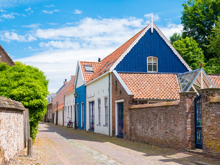 Street scene with walls and houses in old fortified town of Wijk bij Duurstede in province Utrecht, Netherlands Stock Photo
