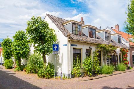 Houses at street corner in old fortified town of Wijk bij Duurstede in province Utrecht, Netherlands Editorial