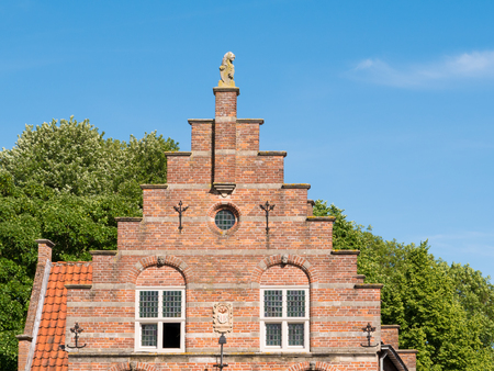 Stepped gable of old town hall in Hoogstraat in fortified city of Woudrichem, Brabant, Netherlands