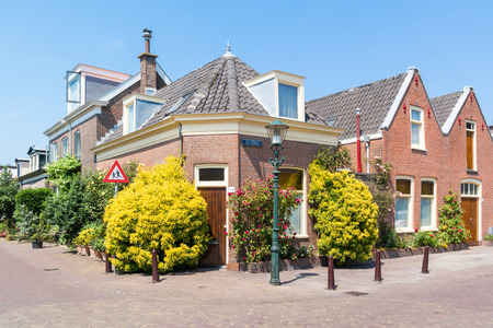 SCHEVENINGEN, NETHERLANDS - JUL 3, 2015: Street scene with houses and front gardens  in old town of Scheveningen, The Hague, South Holland, Netherlands