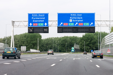 Traffic on motorway interchange A1-A10 and overhead route information signs, Amsterdam, North Holland, Netherlands Editorial