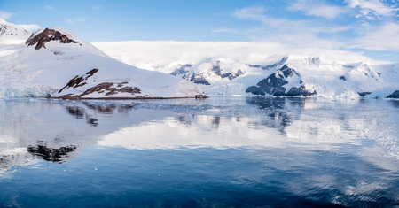 Panorama of Neko Harbour and Lester Cove with glaciers and red tents on camp site, Arctowski Peninsula, mainland of Antarctica