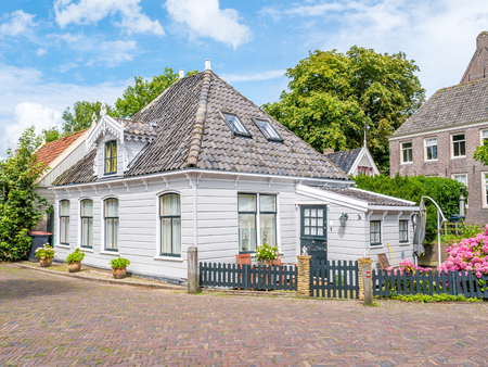 Front of wooden house in historic old village Broek in Waterland, North Holland, Netherlands