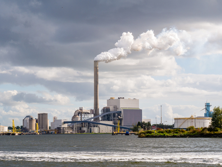 Coal power plant Hemweg with steam from exhaust stack in Westpoort, Port of Amsterdam, North Sea Canal, Netherlands
