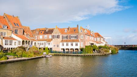 Old brick waterfront houses of De Bocht in Enkhuizen, Noord-Holland, Netherlands
