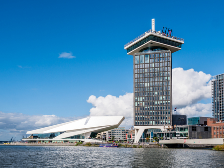 AMSTERDAM, NETHERLANDS - SEP 28, 2018: Adam Tower and Eye Filmmuseum from River IJ in Amsterdam, Netherlands