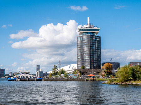 AMSTERDAM, NETHERLANDS - SEP 28, 2018: Adam Tower, Eye Filmmuseum and ferry from River IJ in Amsterdam, Netherlands Editorial