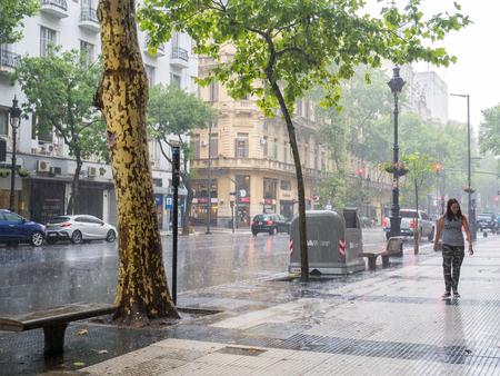 Heavy rain storm at Avenida de Mayo in city centre Microcentro, Monserrat district in capital Buenos Aires, Argentina Editorial
