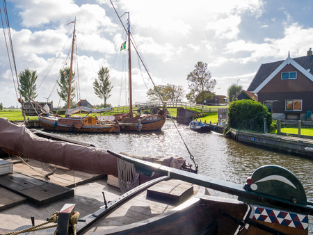 Traditional boats in historic harbour of city of Workum, Friesland, Netherlands
