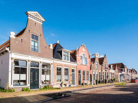 Row of historic houses in old town of Workum, Friesland, Netherlands