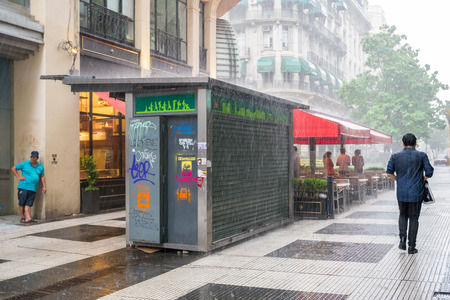 Heavy rain storm in pedestrian zone in city centre Microcentro, Monserrat district in capital Buenos Aires, Argentina Editorial