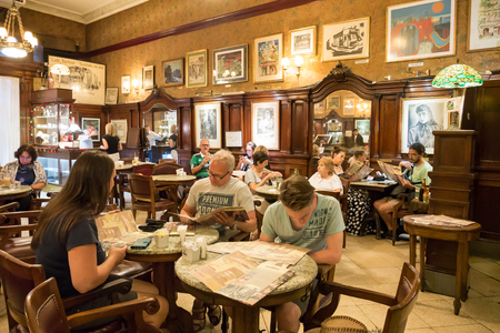 People in cafe Tortoni on Avenida de Mayo in city centre Microcentro in Monserrat district in capital Buenos Aires, Argentina