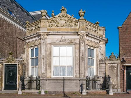 Facade of historic house called Snouck van Loosenhuis in old town of Enkhuizen, Noord-Holland, Netherlands