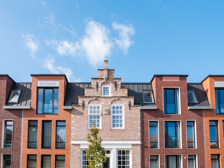 WORKUM, NETHERLANDS - OCT 5, 2017: Top facades of old and new houses in city centre of Workum, Friesland, Netherlands Editorial