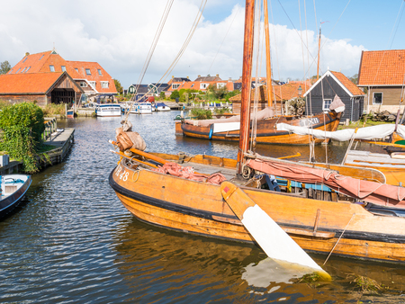 Traditional flatbottom fishing boats moored in shipyard Blazerhaven in historic town of Workum, Friesland, Netherlands