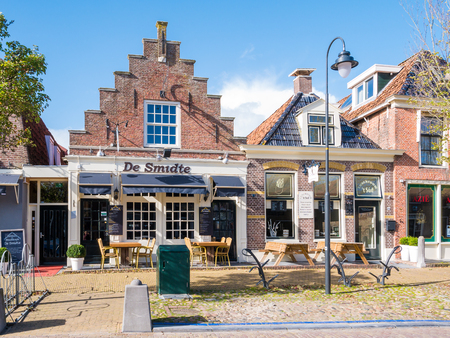 Front facades of historic houses now shops in city centre of old town of Workum, Friesland, Netherlands