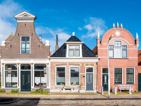 Front view of three historic houses in old town of Workum, Friesland, Netherlands Editorial