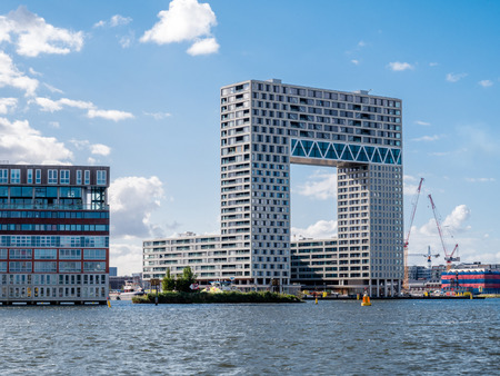 Modern apartment building Pontsteiger in Houthaven on south bank of river IJ, Amsterdam, Netherlands
