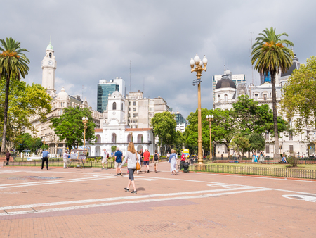 People on main square Plaza de Mayo and Cabildo building in Monserrat district of capital Buenos Aires, Argentina
