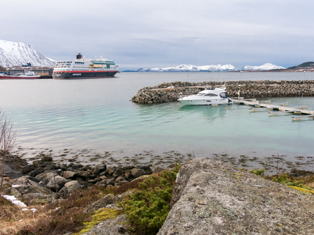 Motor yacht and Hurtigruten cruise ship in Stokmarknes, Hadseloya, Vesteralen, Nordland, Norway Editorial