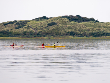 People kayaking near nature reserve Het Oerd on West Frisian island Ameland in Wadden Sea, Friesland, Netherlands