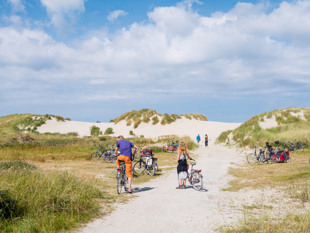 People with bicycles in dunes in nature reserve Het Oerd on West Frisian island Ameland, Friesland, Netherlands