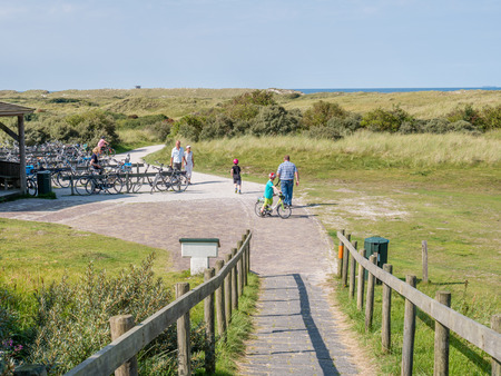 People and bicycles in dunes of nature reserve Het Oerd on West Frisian island Ameland, Friesland, Netherlands