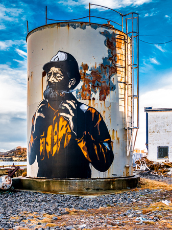 Street art painting on silo by Norwegian artist Pobel in fishing village Henningsvaer, Lofoten islands, Nordland, Norway Editorial