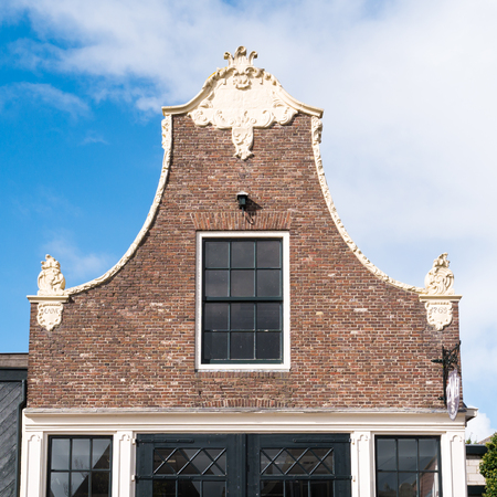 Top of gable of historic house in old town of Workum, Friesland, Netherlands
