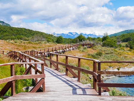 Boardwalk of Puerto Arias in Lapataia Bay with Andes mountains in background, Terra del Fuego National Park near Ushuaia, Patagonia, Argentina