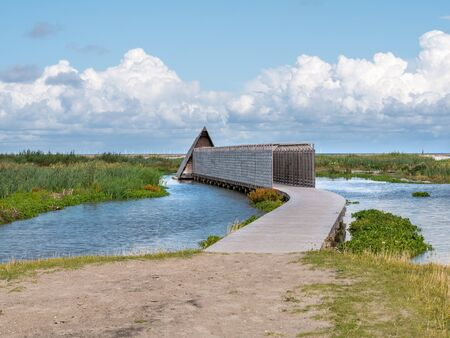 Boardwalk path to bird hide Duikeend on manmade island Marker Wadden in Markermeer, Netherlands