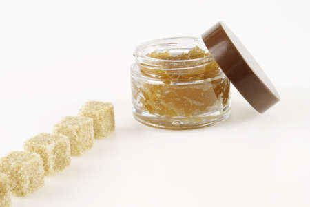Body Scrub, row of pieces of brown sugar, on a white background