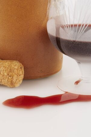potation: Glass with red wine, cork and clay bottle                        Stock Photo