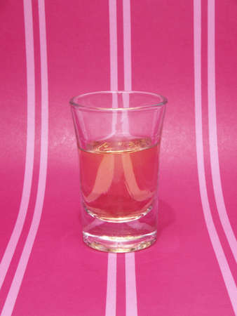 ounce shot on pink background