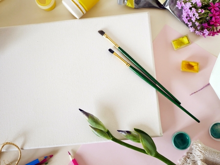 Background for congratulations, still life of artistic materials and flowers